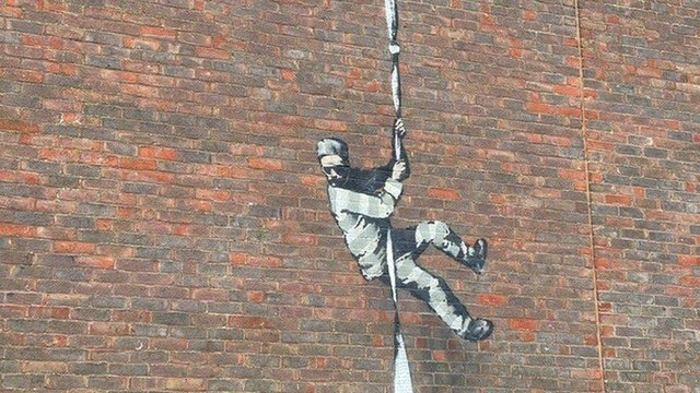 Banksy has yet to confirm whether he painted the prisoner escaping on the HMP Reading wall (Picture: BBC)