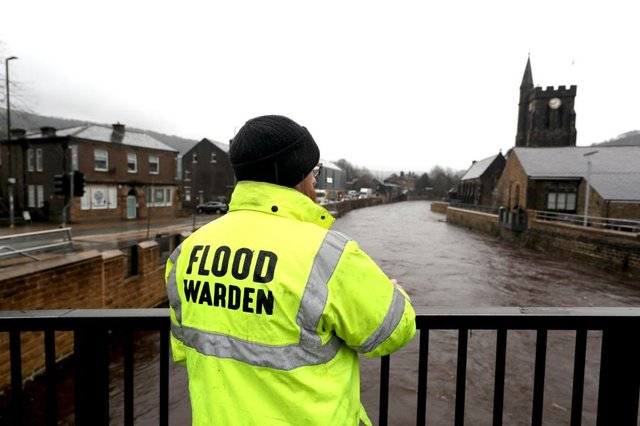 A flood warden looks at the water levels of the River Calder in Mytholmroyd in the Upper Calder Valley in West Yorkshire, in anticipation of Storm Christoph which is set to bring widespread flooding, gales and snow to parts of the UK. (Pic: PA)