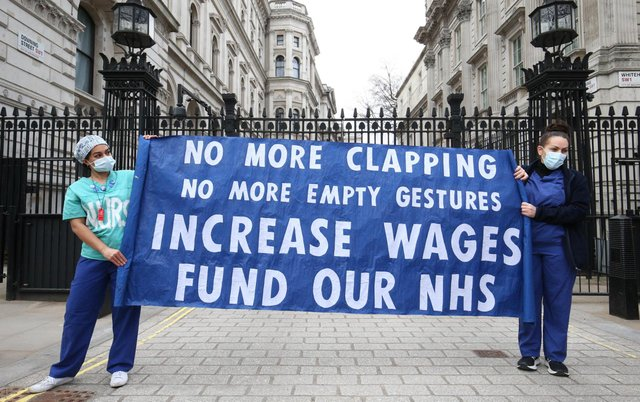 Nurses and NHS workers from the campaign group NHS Workers Say No, and Unite's Guys and St Thomas Hospital Union branch, hold a socially distanced protest outside Downing Street in London over the proposed 1% pay rise from the Government. (Pic: PA)