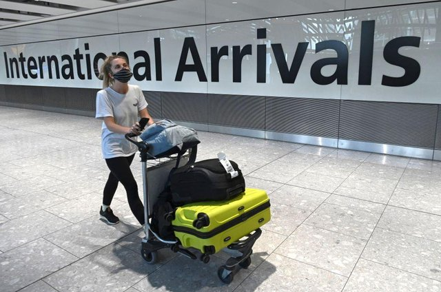 Travellers arriving in England will be able to end their quarantine period with a negative coronavirus test after five days from 15 December (Photo: DANIEL LEAL-OLIVAS/AFP via Getty Images)