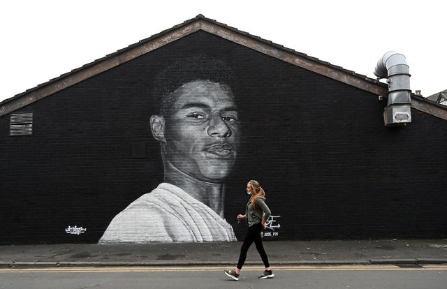 (A mural by grafitti artist Akse P19 of Manchester United football player Marcus Rashford - Photo by PAUL ELLIS/AFP via Getty Images)