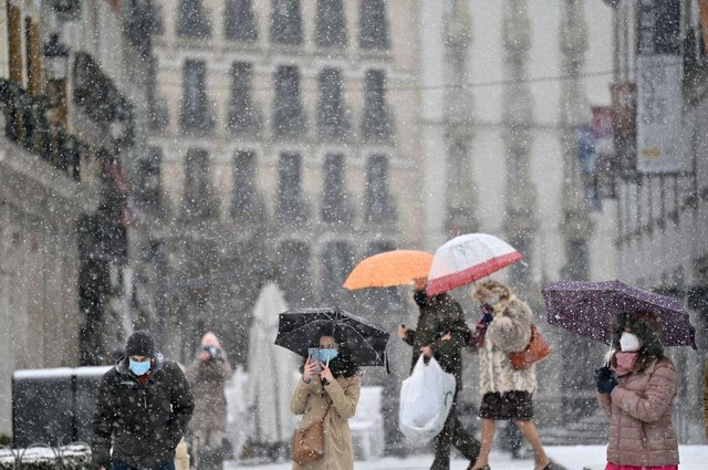 People walk in the snow in Madrid as storm Filomena affects parts of Spain (Getty Images)